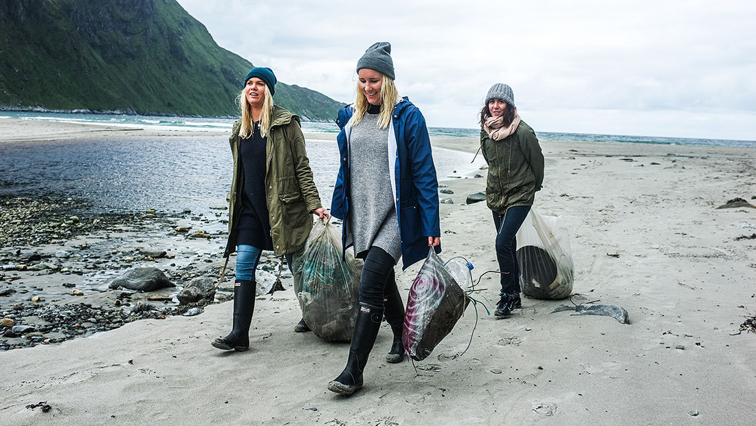 Activist from Nordic Ocean Watch cleaning a Norwegian surf beach.