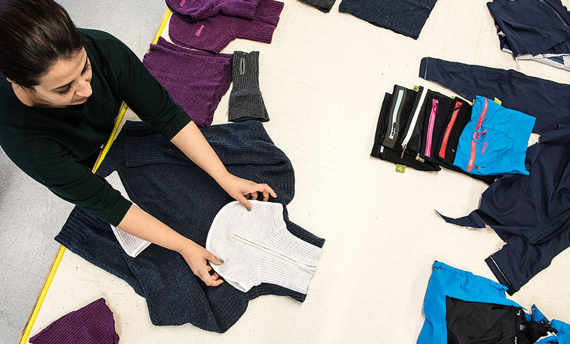 Designer working new clothes made of old ones